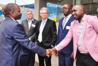 TOP: Jerome Ochieng', the ICT PS – left – shakes hands with Dan Kwach, GM, EADC, during the opening of the facility's third floor. Looking on are other Liquid Telecom execs and invited guests.