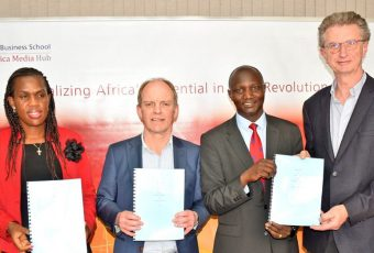 Representatives from Strathmore University and WaterWatch Projects holding the MoU.